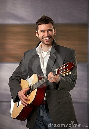 Trendy guy with guitar