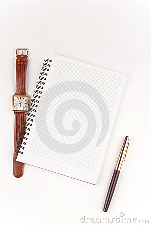 Notebook, pen and wristwatch