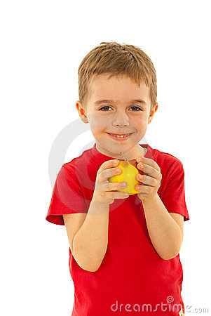 Happy boy eating apple