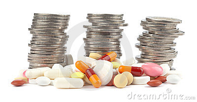 Three rolls of Euro Coins and spilled pills