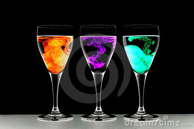 Three wine glasses with food coloring