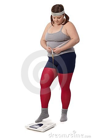Fat woman measuring waistline and weight
