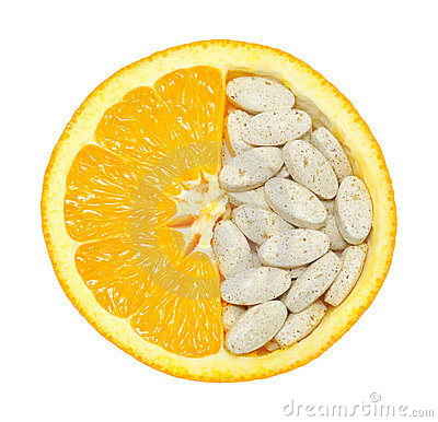 Close up of orange and pills isolated