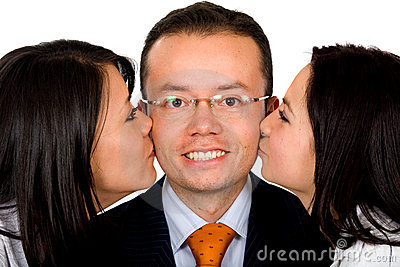 Business man being kissed