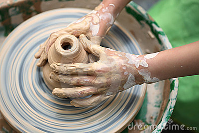 Child hand do ceramics