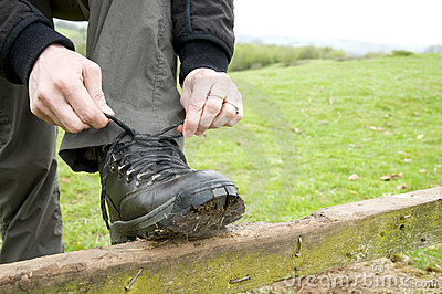 Woman tying boot laces