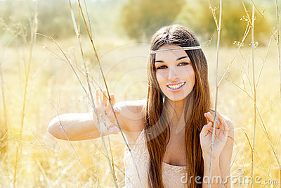 Asian indian woman portrait in golden autumn field