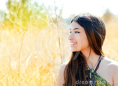 Asian indian woman profile in golden field