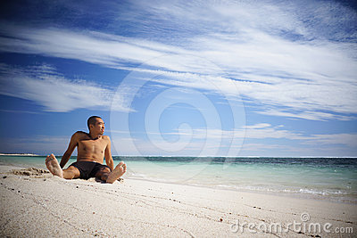 Asian guy relaxing on the beach