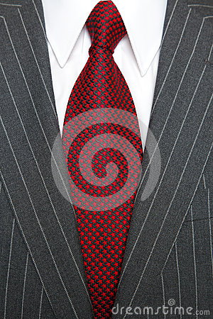 Grey pinstripe suit and red tie