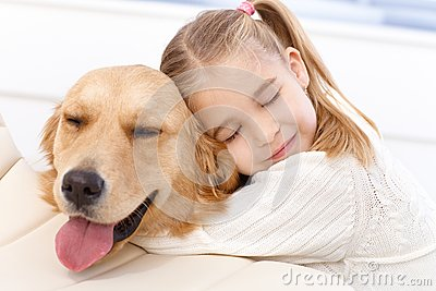 Lovely little girl and her pet dog