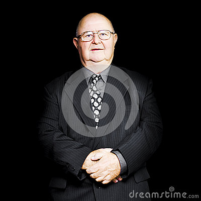 Senior business man isolated on black background