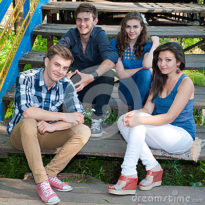 Happy group of Young people posing outdoors