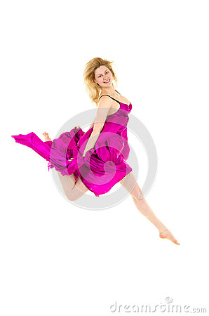 Happy female dancer in pink jumping