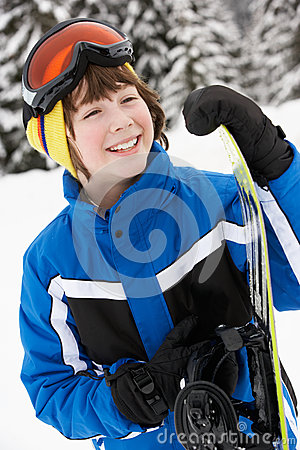 Young Boy With Snowboard On Ski Holiday