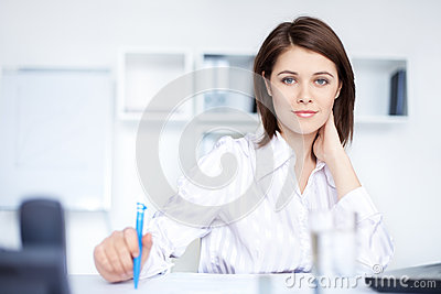 Relaxed young business woman woman in office