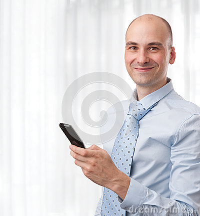 Smiling businessman with phone