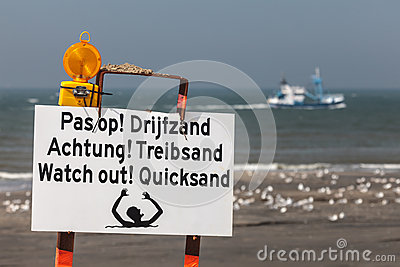 Beach sign warning for quicksand