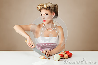 Young woman cutting onion