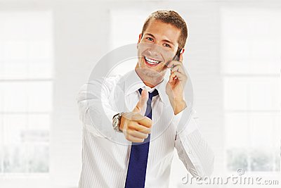 Smiling young business man with a phone