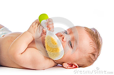 Baby with hairbrush