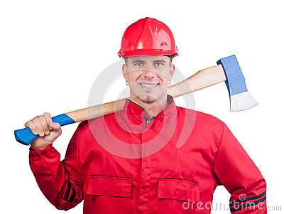 Young smiling fireman with hard hat and ax