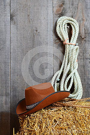 Cowboy hat on straw with ropes