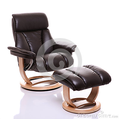 Luxurious leather recliner chair with footstool