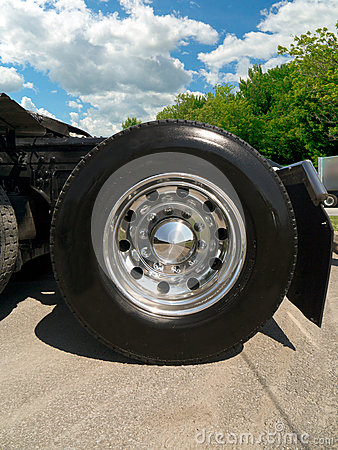 Truck tire with chrome wheel on a tractor truck