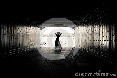 Silhouette of a girl in a tunnel