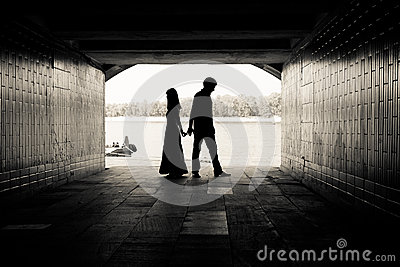 Silhouette of a couple in a tunnel