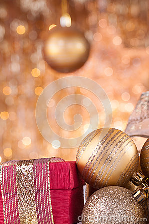 Gold christmas baubles and red box