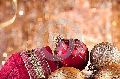 Gold and red christmas baubles and red box