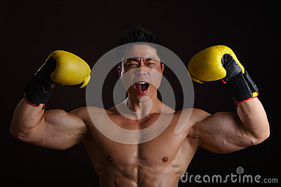 Asian Man with yellow boxing gloves posing