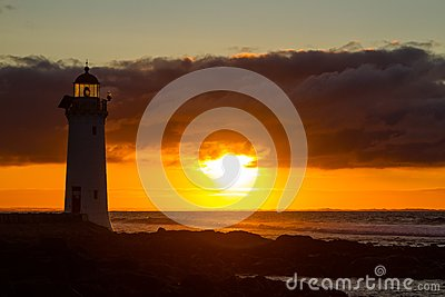 Port Fairy lighthouse, VIC glowing red sunrise