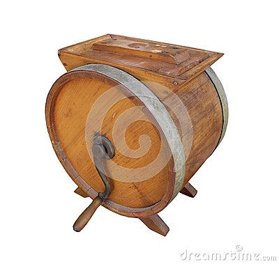 Old wooden crank butter churn isolated