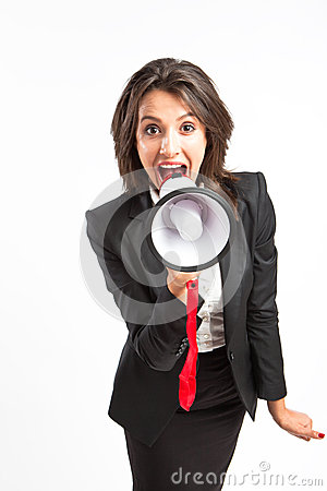 Business woman yelling in megaphone