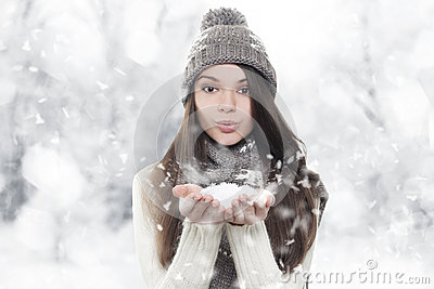 stock image of winter portrait. young, beautiful woman blowing snow