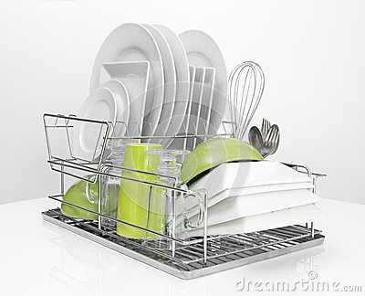 Bright dishes drying on metal dish rack