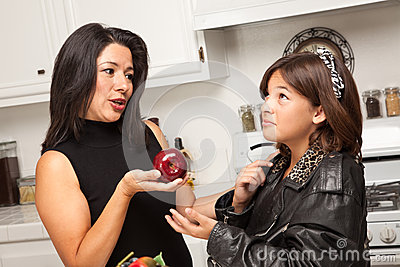 Young Hispanic Girl Ready for School with Mom