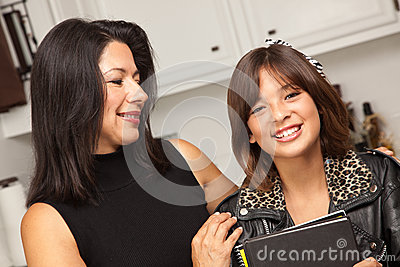 Happy Hispanic Girl Ready for School with Mom