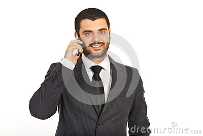 Smiling business man by cell phone