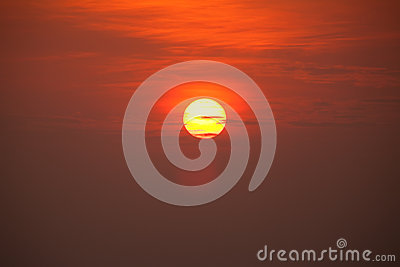 Sun with cloudy sky at sunset