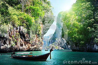 Long boat and rocks on railay beach in Thailand