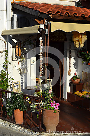 Typical Greek garden with flower pots with flowers and plants.