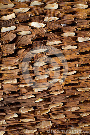 Threshing board of aged wood and stones texture