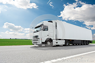 White lorry with trailer over blue sky