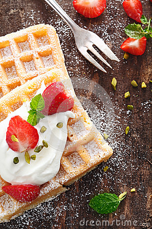 Waffle and strawberries with cream