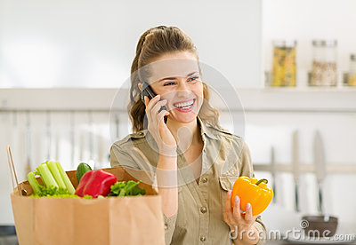 Young housewife sort purchases after shopping