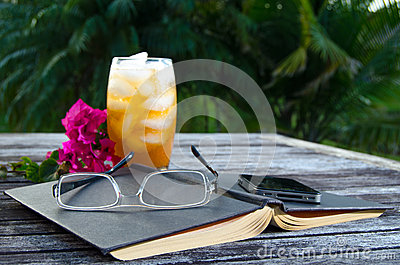 Open book with ice tea outside